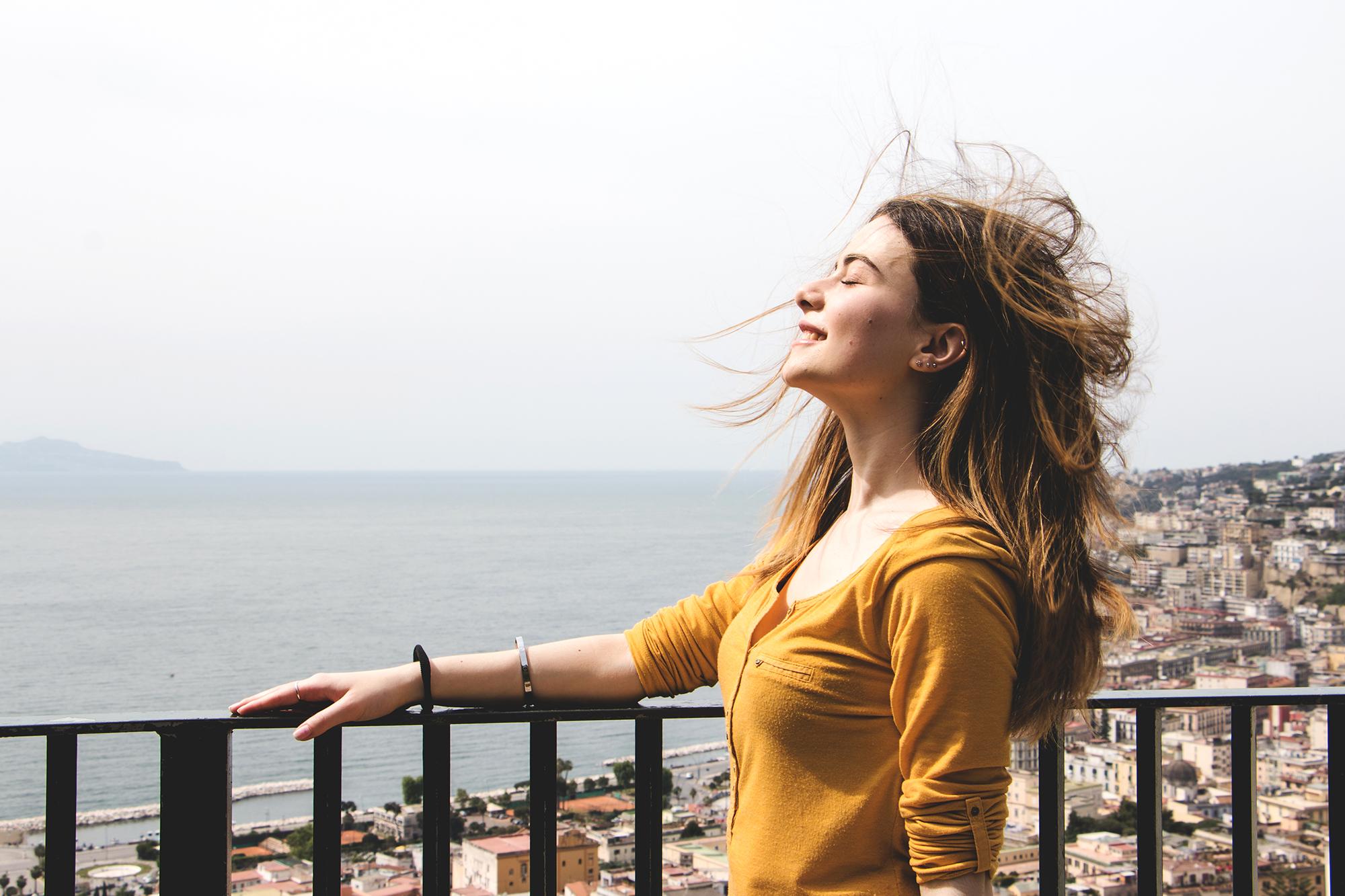 woman-enjoying-breath-wind